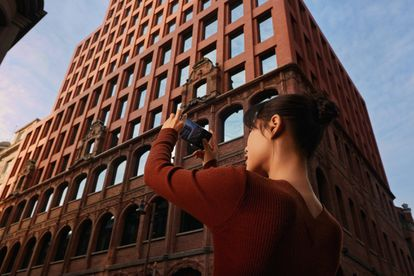 A user takes a photo with the OPPO Find X3 Pro 5G.